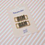paire de lace locks bim bam en métal doré et écriture noire