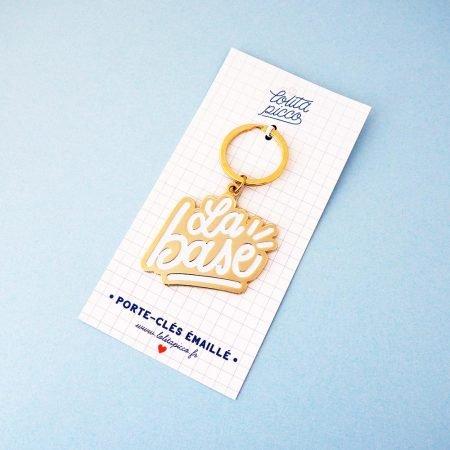 porte clef la base doré et blanc et son packaging